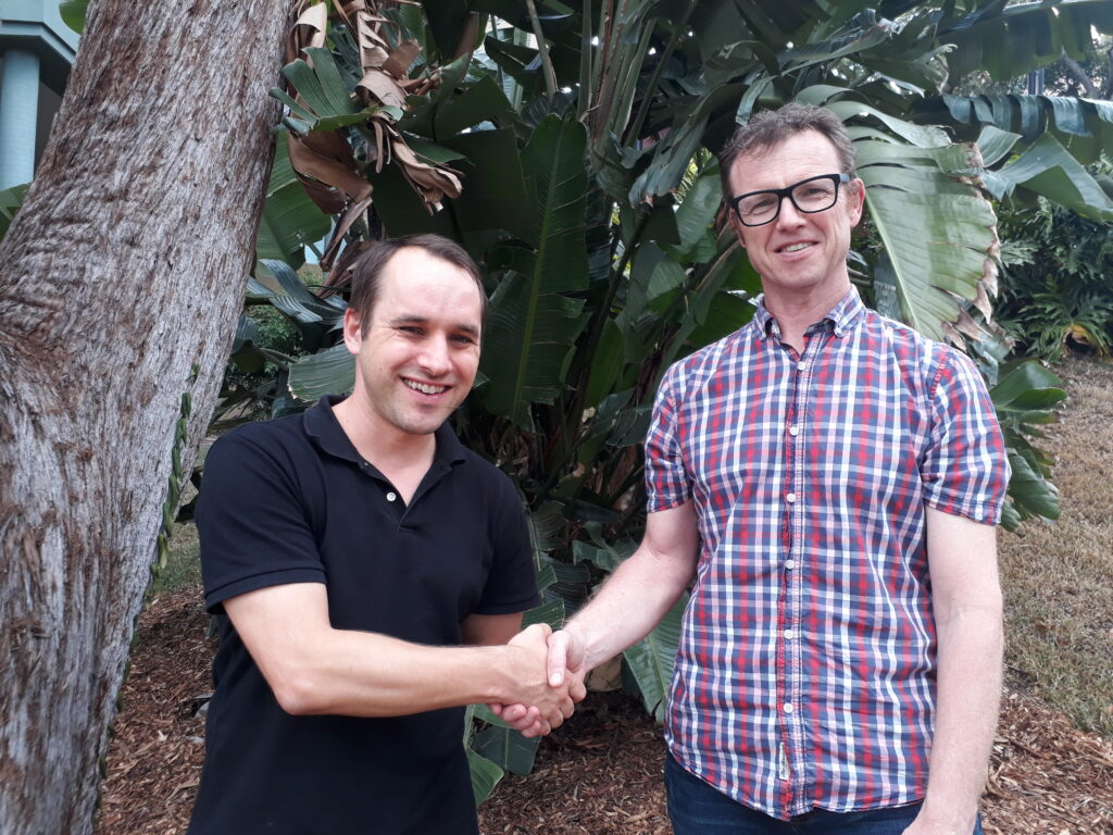 Image of Michael Waller shaking hands with Adrian Barnett